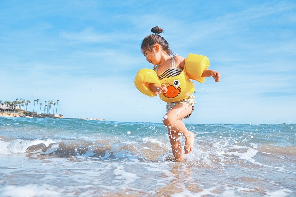 Little girl splashing on holiday